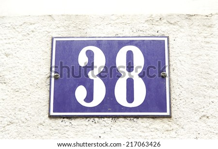 Number thirty-eight on a wall, detail of an even number of information on the wall of a house - stock photo