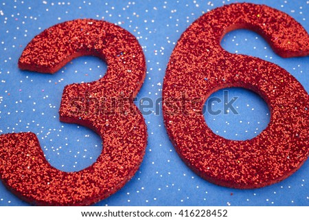 Number thirtysix red color over a blue background. Anniversary. Horizontal