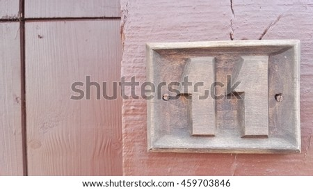 number 11 woodcarving form old town - stock photo