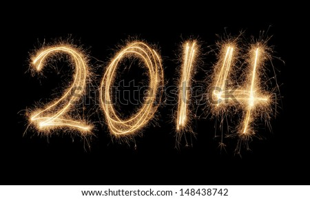 Number 2014 written with a sparkler. - stock photo