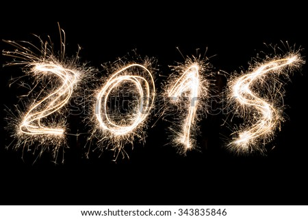 Number 2015 written with a sparkler.Happy new year 2015 written with Sparkle firework - stock photo