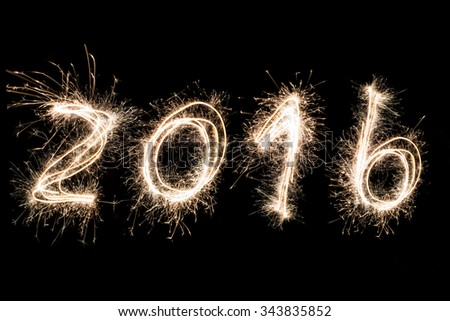 Number 2016 written with a sparkler.Happy new year 2016 written with Sparkle firework - stock photo