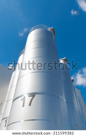 numbered industrial tanks for the food industry - stock photo