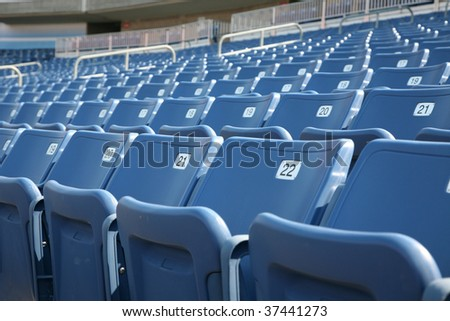 Numbered seats in a stadium - stock photo