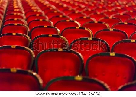 numbered theater chairs with red velvet  - stock photo