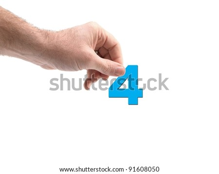 Numbers held by a hand isolated against a white background - stock photo