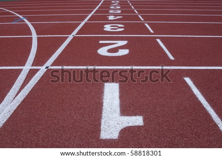 Numbers of a racetrack on red tarmac for runners abstract arena athlete