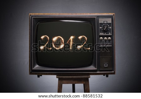 numbers of Bengali -fire in 2012 on the screen of retro TV. - stock photo