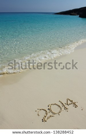 Numbers 2014 on beach - stock photo
