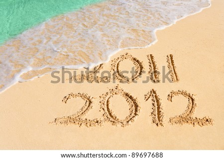 Numbers 2012 on beach - concept holiday background - stock photo