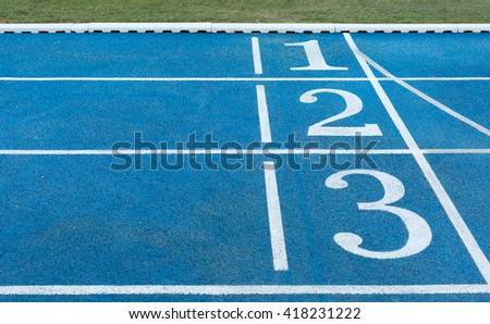 Numbers on blue running track