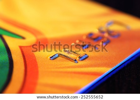 Numbers on plastic card on wooden table, macro view - stock photo