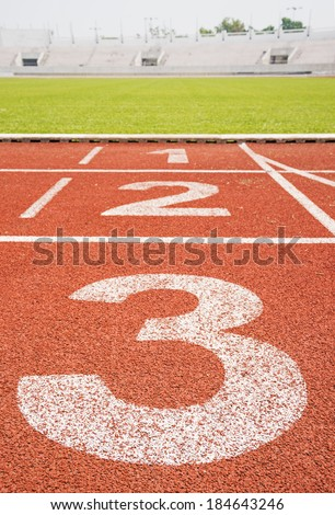 numbers on running track - stock photo