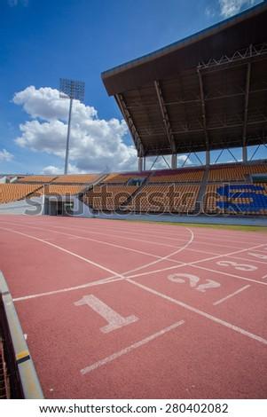 Numbers on running track  in stadium - stock photo