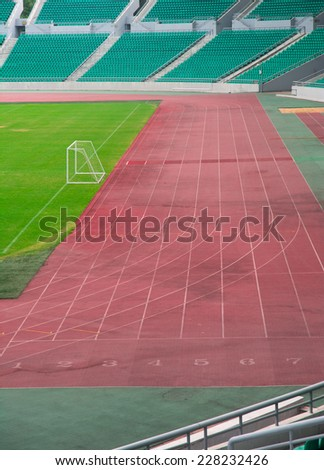 Numbers on the red running track - stock photo