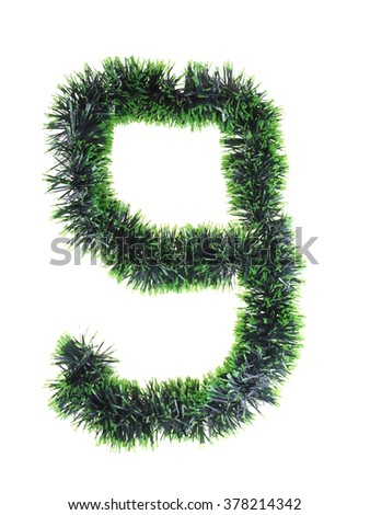 numeral from green Christmas tree decorations on a white background