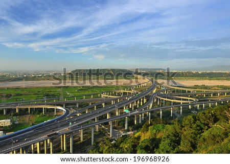 Numerous busy highway lanes on a sunny day. - stock photo