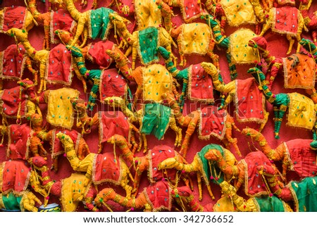 Numerous colorful hand made toy camels stocked up for sale in Rajasthan, India. - stock photo
