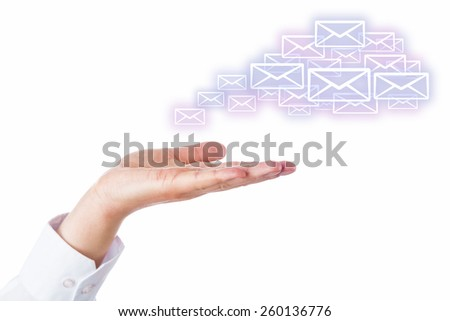 Numerous email icons rising from an open palm of a hand to shape a virtual cloud. Business symbol or metaphor for cloud computing. Cutout isolated on white. Artwork space for your smart phone product. - stock photo