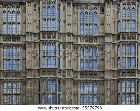 Numerous windows of the british parliament, in a detailed shot showing only twelve windows - stock photo