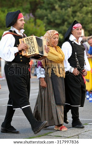 Nuoro, Sardinia, Italy - August 23, 2015: Musicians in the parade of traditional costumes of Sardinia on the occasion of the Feast of the Redeemer of August 23, 2015 in Nuoro, Sardinia.