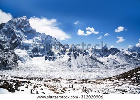 Nuptse mount and Khumbu glacier in Sagarmatha National Park, Nepal Himalaya. Nuptse is a mountain in the Khumbu region of the Mahalangur Himal. It lies two kilometres of Mount Everest. - stock photo