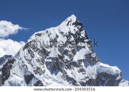 Nupttse, peak in the Himalayas, Nepal, Everest track, Spring 2012 - stock photo