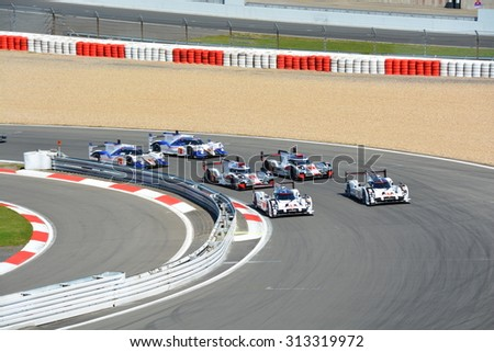 NURBURG, GERMANY - AUGUST 30: The six cars of Porsche, Audi and Toyota lined up before the start of round 4 of the FIA World Endurance Championship on August 30, 2015 at Nurburg, Germany. - stock photo