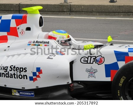 NURBURG, GERMANY - JULY 12, 2014: British racing driver Oliver Rowland (Fortec Motorsport) during the World Series by Renault event on July 12, 2014 at Nurburg, Germany.  - stock photo