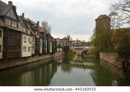NUREMBERG, GERMANY - APRIL 10, 2016. View of historic buildings on Pegnitz riverside and covered bridge in Nuremberg old town district.