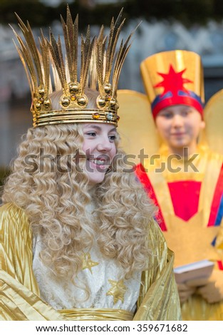 NUREMBERG, GERMANY-DECEMBER 2, 2015: Barbara Otto as an angel,  know as Christkind visits with the angel assistant the Main Market in Nuremberg during Christmas Market, known as Christkindlesmarkt  - stock photo