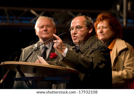 NUREMBERG, September 25, 2008: Gregor Gysi, famous German left-wing poltician is speaking in a rally. Oskar Lafontaine and Anny Heike are standing behind him. Nuremberg, Germany, 2008/09/25. - stock photo