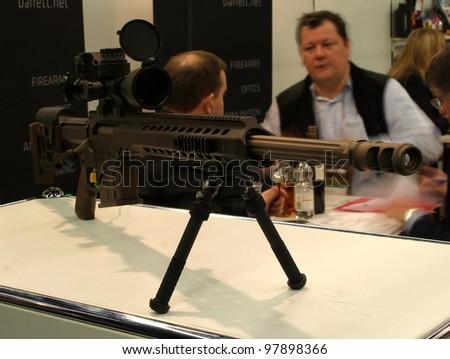 NURNBERG, GERMANY - MARCH 11: Barrett MRAD sniper rifle on display at IWA 2012 & OutdoorClassics exhibition on March 11, 2012 in Nurnberg, Germany - stock photo