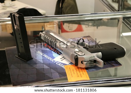 NURNBERG, GERMANY - MARCH 9: Desert Eagle handgun on display at IWA 2014 & Outdoor Classics exhibition on March 9, 2014 in Nurnberg, Germany - stock photo