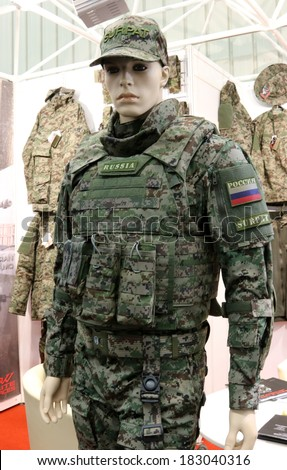 NURNBERG, GERMANY - MARCH 9: Russian uniform produced by Surpat on display at IWA 2014 & Outdoor Classics exhibition on March 9, 2014 in Nurnberg, Germany - stock photo