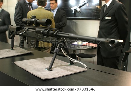 NURNBERG - MARCH 11: Sig Sauer SAN 511 sniper rifle on display at IWA 2012 & OutdoorClassics exhibition on March 11, 2012 in Nurnberg, Germany - stock photo
