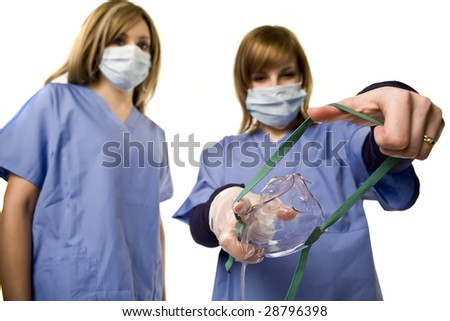 Nurse and doctor holding anesthesia mask isolated on white - stock photo