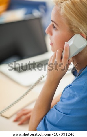 Nurse calling in hospital reception - stock photo
