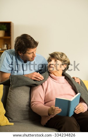 Nurse caring about senior patient in nursing home
