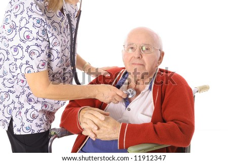 nurse checking elderly mans pulse - stock photo