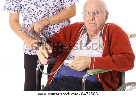 nurse checking elderly patients blood pressure - stock photo
