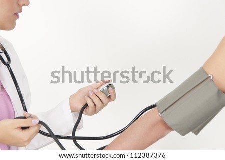 Nurse checking her patient's hypertension. - stock photo