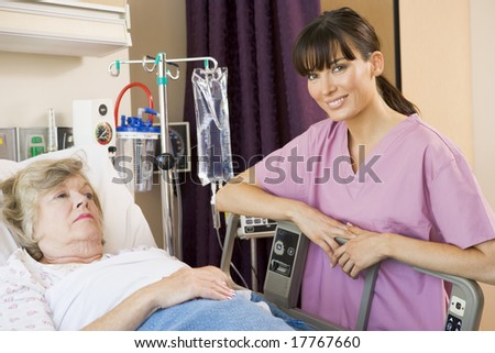 Nurse Checking Up On Patient - stock photo