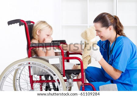 nurse cheer up sad little girl patient - stock photo