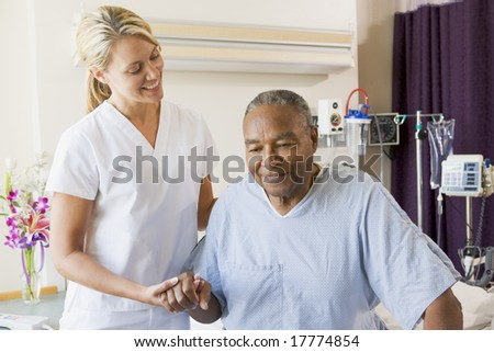 Nurse Helping Senior Man To Walk - stock photo