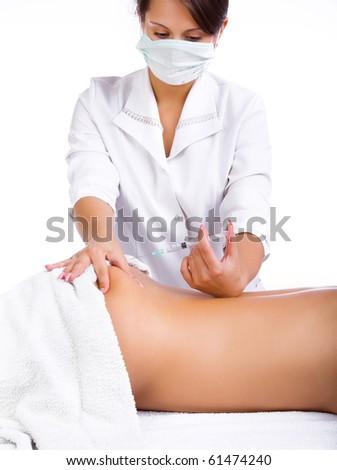 Nurse hold syringe in hand - stock photo