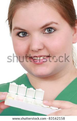 Nurse holds medicine - stock photo