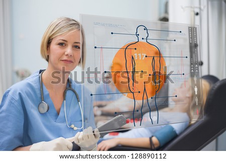 Nurse looking an interface during a blood donation - stock photo
