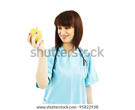 Nurse or young doctor with apple, smiling. Health care concept isolated on white background.