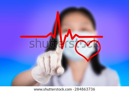 Nurse pressing cardiogram  show cardiology background